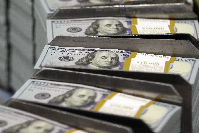 Новчанице од 100 долара приликом штампања у Бироу за гравирање и штампу у Форт Ворту (Тексас), 24. септембар 2013. (Фото: AP Photo/LM Otero)