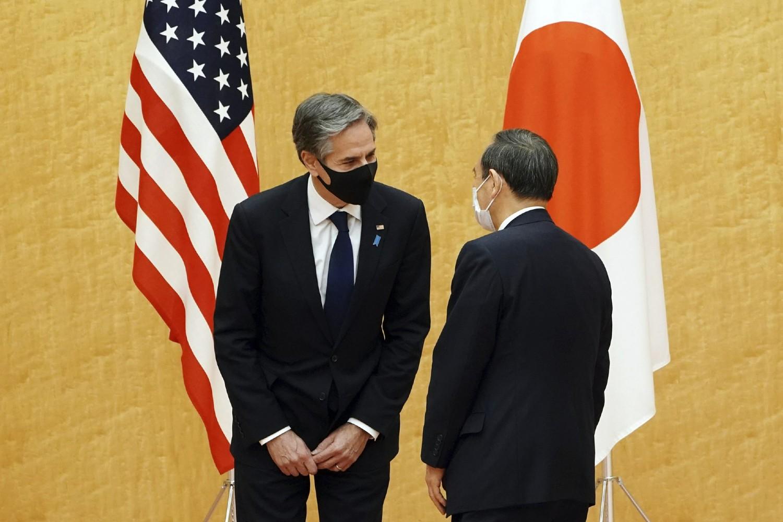 Američki državni sekretar Entoni Blinken tokom razgovora sa japanskim premijerom Jošihideom Sugom prilikom posete Japanu, Tokio, 16. mart 2021. (Foto: AP Photo/Eugene Hoshiko, Pool)