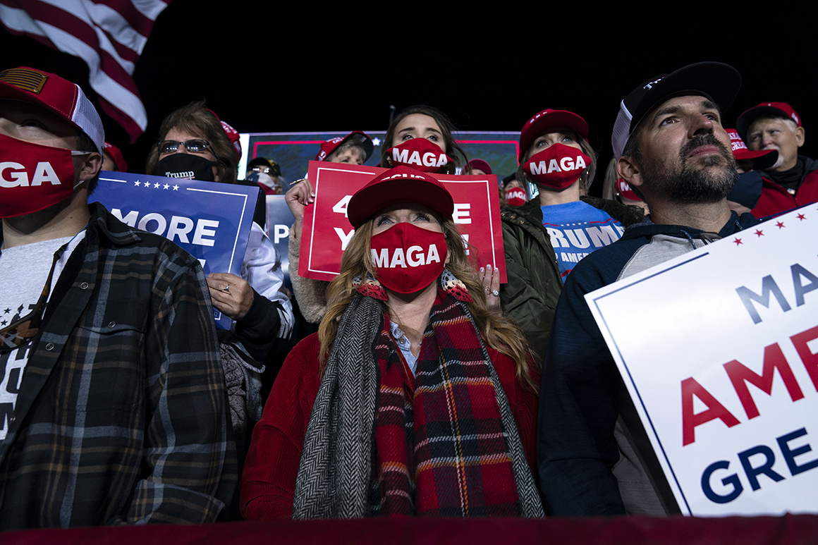 Supporters of President Donald Trump listen to him speak during a campaign rally at Richard B. Russell Airport, Sunday, Nov. 1, 2020, in Rome, Ga. (AP Photo/Evan Vucci)
