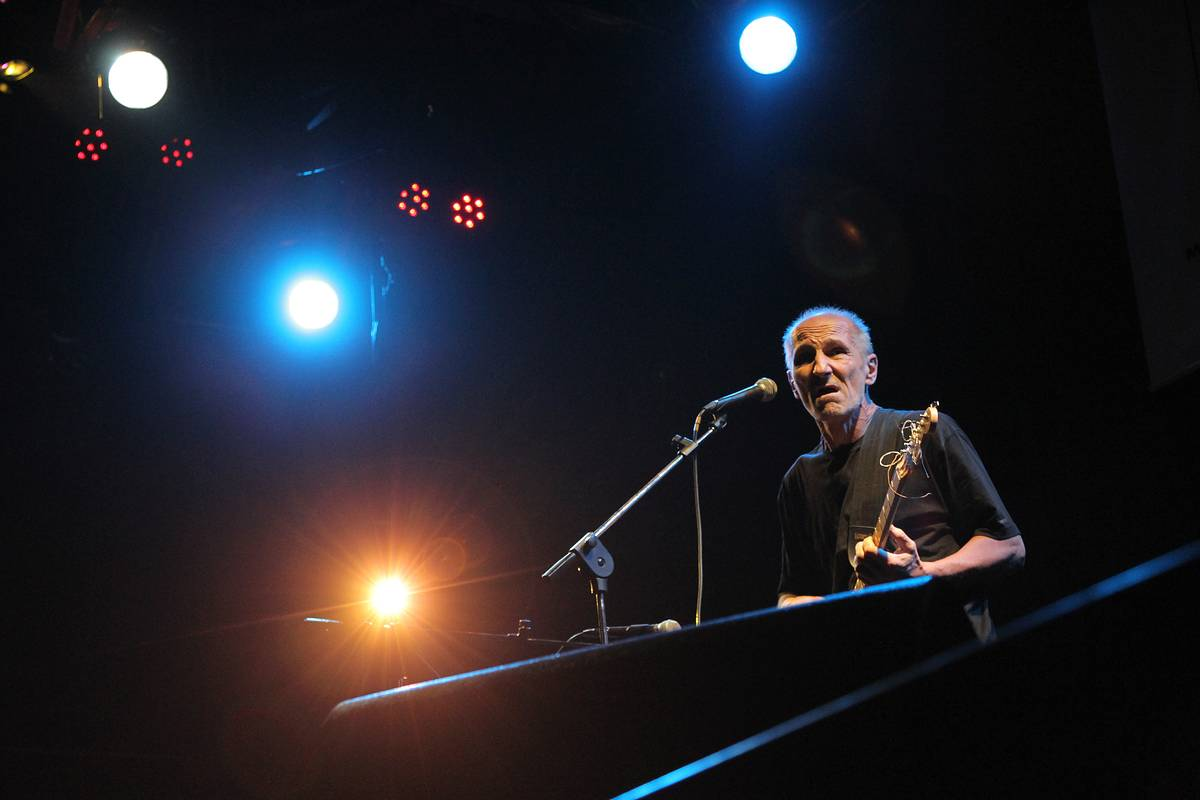 Well-known Russian rock musician and actor Pyotr Mamonov performs at his concert in the B2 Club in Moscow, Saturday, July 16, 2011. (AP Photo/Sergey Savostyanov)