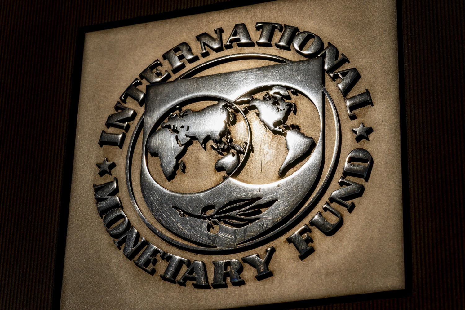 FILE - The logo of the International Monetary Fund is visible on their building, Monday, April 5, 2021, in Washington. Finance officials of the world's major economies on Wednesday, April 7, 2021 agreed on a proposal to boost the resources of the International Monetary Fund by $650 billion as a way to provide more support to vulnerable countries struggling to deal with a global pandemic. (AP Photo/Andrew Harnik)