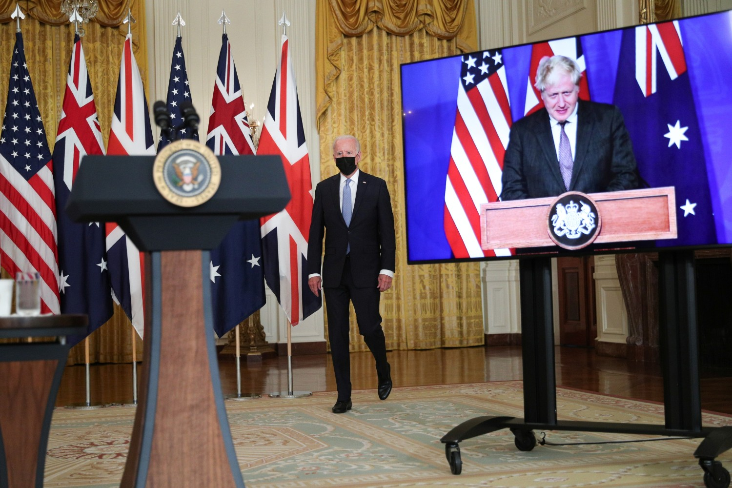 U.S. President Joe Biden walks to the podium before his remarks on a National Security Initiative virtually with Australian Prime Minister Scott Morrison and British Prime Minister Boris Johnson, inside the East Room at the White House in Washington, U.S., September 15, 2021. Reuters/Tom Brenner