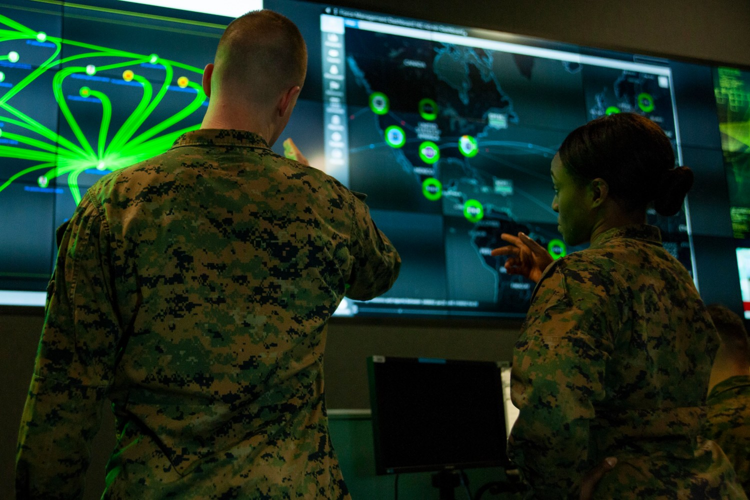 Marines with Marine Corps Forces Cyberspace Command observe computer screens at a cyber operations center at Fort Meade, Md., Feb. 5, 2020.